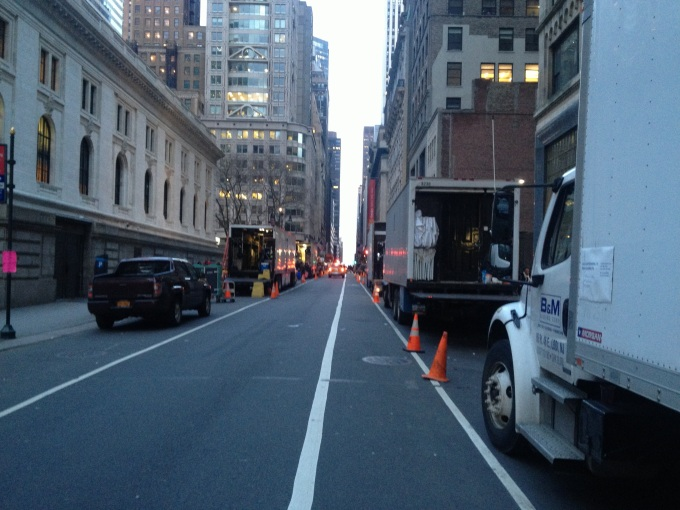 Part of a line of film crew trucks along 40th Street between 5th and 6th Avenues in Manhattan on the south side of Bryant Park.