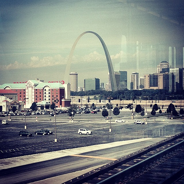 A view of the Gateway Arch from the Metrolink going over the historic Eads Bridge over the Mississippi River at St. Louis, Missouri.